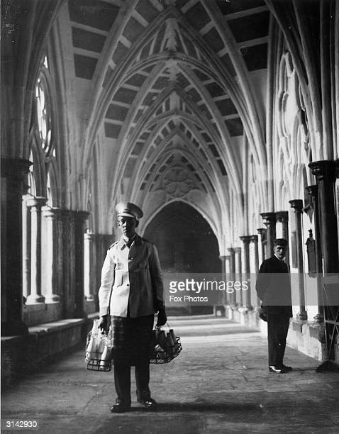 An Express Dairy man delivering milk to Westminster Abbey