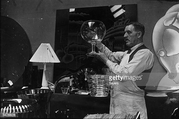 Mr J Baker a carpenter at the Royal Academy displays a giant glass goblet to the Selection Committee at Burlington House London in preparation for...