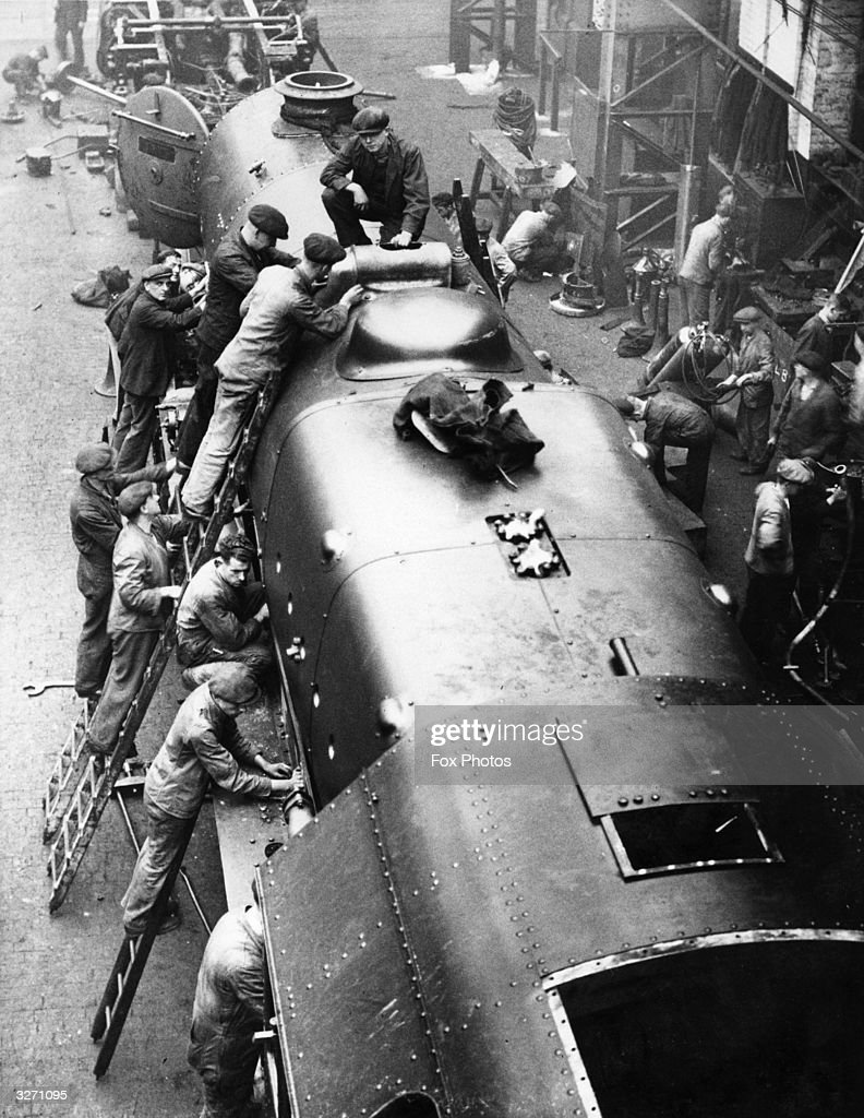 Men at work on the 'British Legion' the first Royal Scot class locomotive to be fitted with a tapered boiler for a streamlined effect at the LMS...