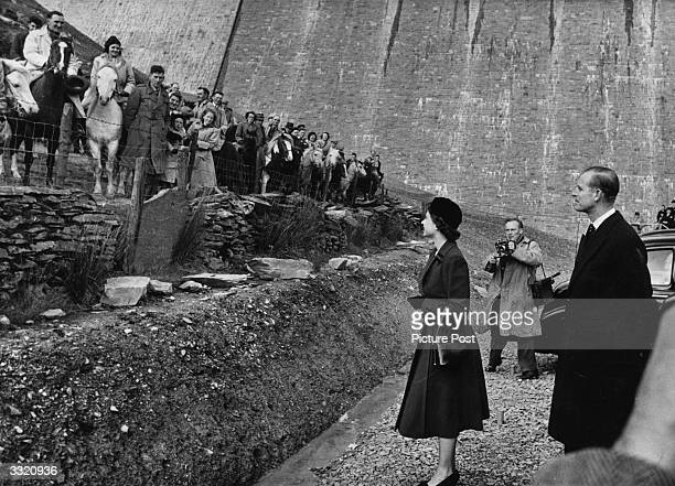 Queen Elizabeth II accompanied by the Duke of Edinburgh Prince Philip inaugurates the new reservoir on the river Claerwen in Elan valley Radnorshire...