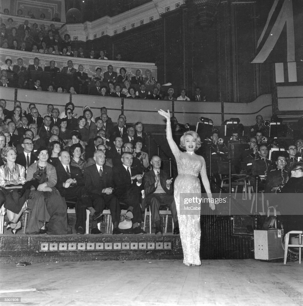 German-born American actress and singer Marlene Dietrich (1901 - 1992) on stage at the Royal Albert Hall, London, to sing at the Alamein Reunion.