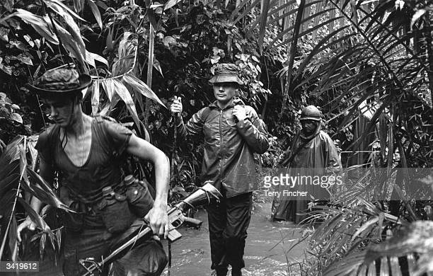 Troops on patrol with Lieutenant Colonel Colin 'Mad' Mitchell