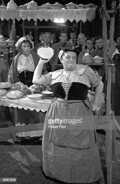 British actress Joan Young prepares to throw a custard pie in the slapstick film 'Cardboard Cavalier' Original Publication Picture Post 4648 A Pie...