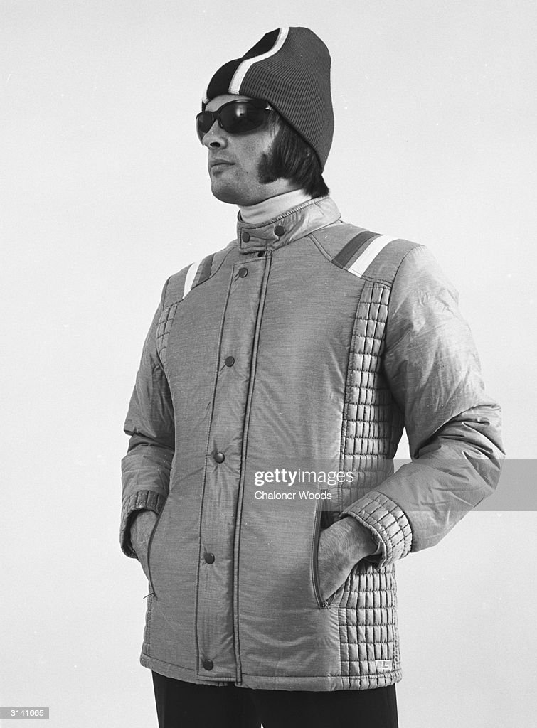A young man in a knitted hat and goggles looking cool in a Gordon Lowe catalogue with his hands in the pockets of a ski jacket.