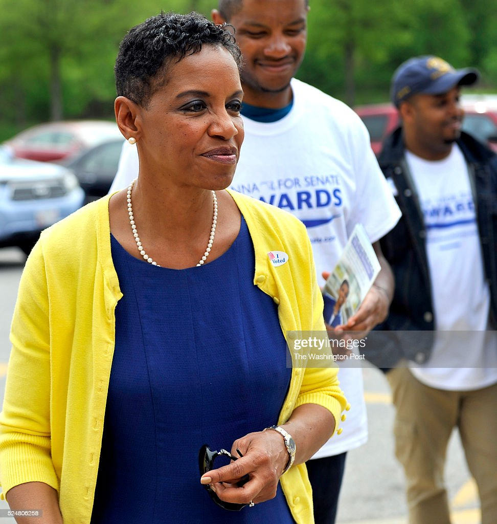 Congress woman Donna Edwards talking with a voter outside Charle Herbert Flowers high school on April 26, 2016 in Springdale, Md.