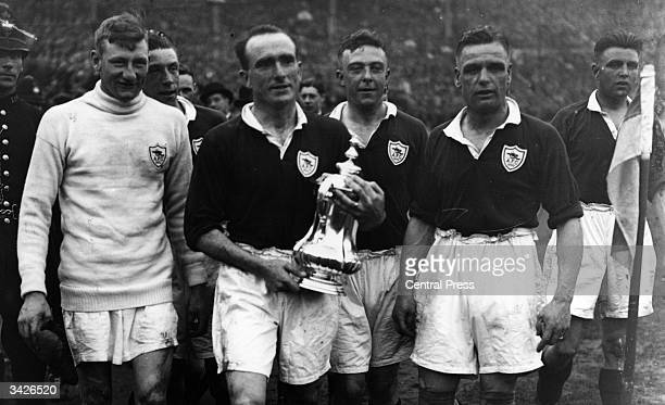 Arsenal captain Tom Parker holding the FA Cup after beating Huddersfield 20 at Wembley