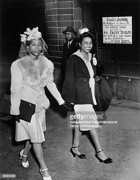 Two women leaving the Abyssinian Baptist Church in Harlem New York on Easter Sunday dressed in their sunday best Photo by Weegee/International Center...