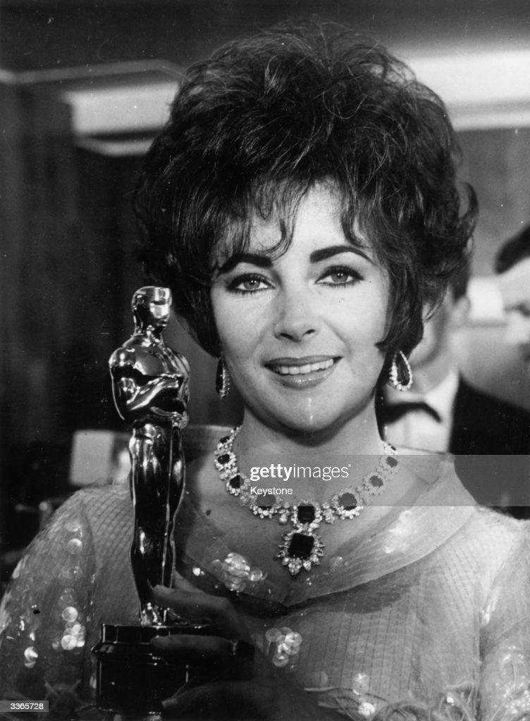 Elizabeth Taylor holding an Oscar she won for the film 'Who's afraid of Virginia Woolf' at the Grosvenor Hotel London