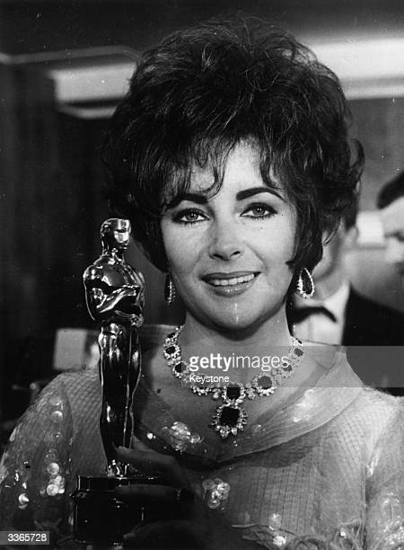 Elizabeth Taylor holding an Oscar she won for the film 'Who's afraid of Virginia Woolf' at the Grosvenor Hotel London