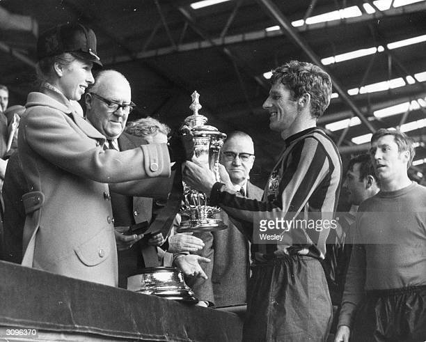 Manchester City Football Club captain Tony Book is presented with the FA Cup by Princess Anne after beating Leicester by 10 at Wembley
