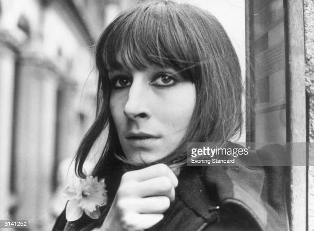 Film actress Anjelica Huston with a daffodil in her buttonhole
