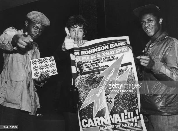 English singersongwriter Tom Robinson and two members of Birmingham reggae band Steel Pulse promote an AntiNazi League rally in London on 30th April