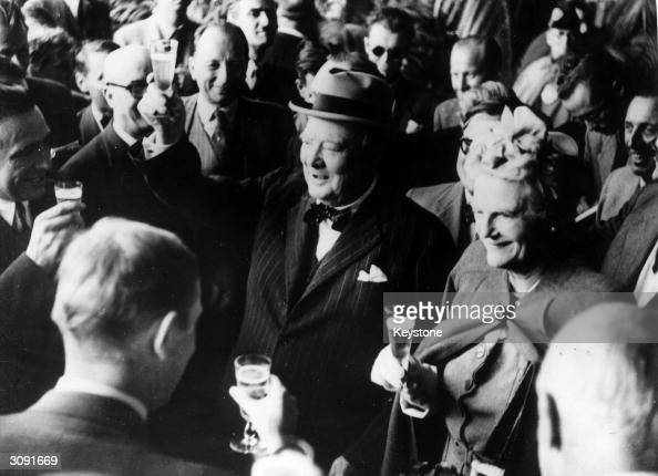 Former British prime minister Winston Leonard Spencer Churchill and his wife Clementine make a toast upon their arrival in Switzerland