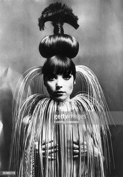 Italian fashion model and actress Elsa Martinelli wearing her hair in a giant topknot