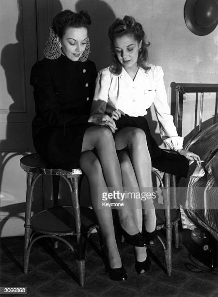 Models wearing nylon stockings at a fashion display organised by the Hosiery Manufacturers' Federation at the Waldorf Hotel in London