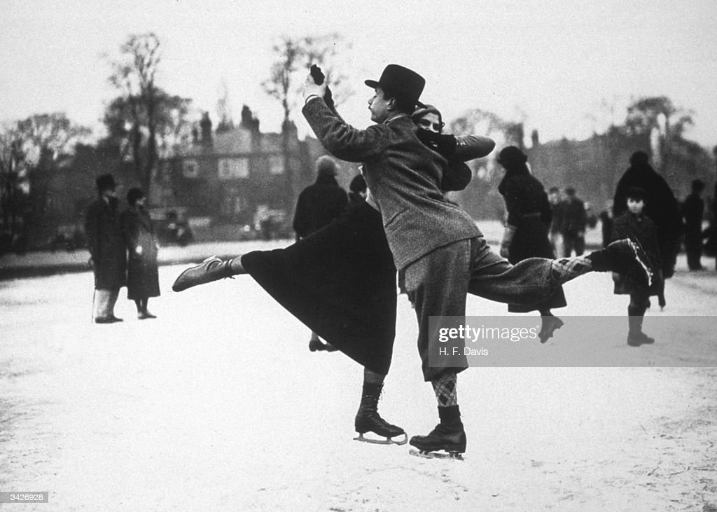 A couple dancing on ice-skates on Whitestone Pond, Hampstead, London.