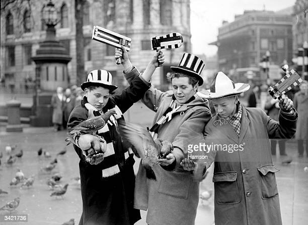 Three young Newcastle United fans Ernie Anderson Andrew Hurst and Jackie Clark feed the pigeons in Trafalgar Square London before Newcastle's fourth...