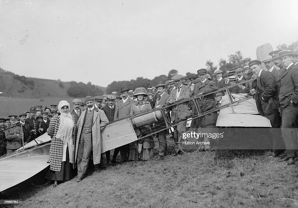 French aviation pioneer Louis Bleriot poses for a commemorative photograph with his wife and friends near Dover Castle the day after completing the first crossing of the English Channel. Count Charles de Lambert is seen to the right in dark cap and overcoat, standing between the wheel and the tail of the plane. Lambert competed against Bleriot for the Channel crossing, and made the first flight over Paris three months later.