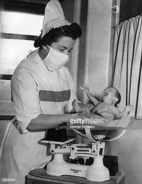 Nurse Lupton weighs baby Heather Hall at the Great Ormond St Children's Hospital London When Heather was born she weighed only 2lbs and 10 ounces She...
