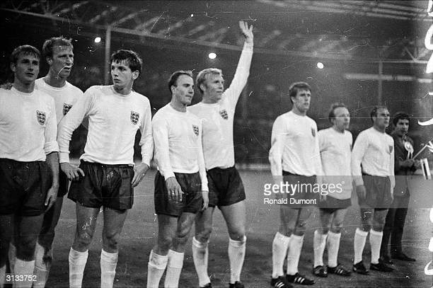 Members of the England football team Roger Hunt Jack Charlton Martin Peters Ray Wilson Bobby Moore Geoff Hurst Nobby Stiles and George Cohen during...