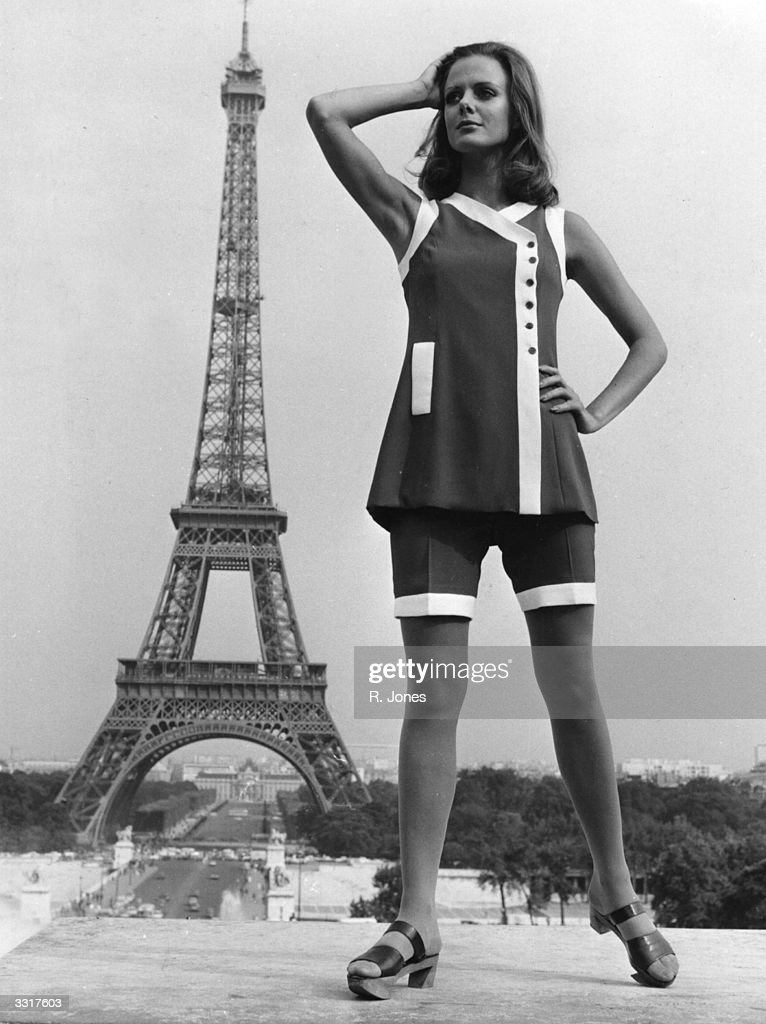 A model poses in front of the Eiffel Tower, wearing the latest Paris fashion.