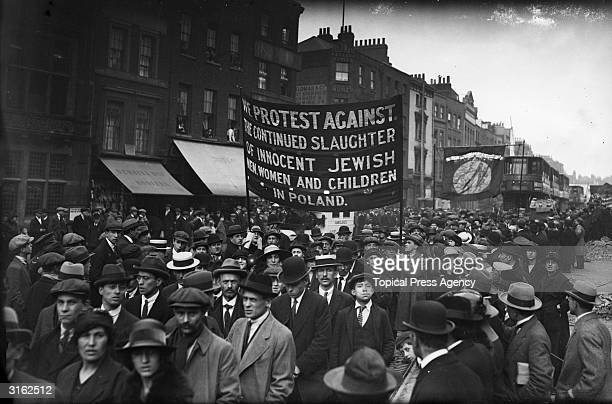 Jewish men in Whitechapel east London march in protest against the killing of Jews in Poland