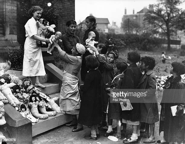 Basque children being given toys in Watermillock Bolton where they are refugees from the Spanish Civil War