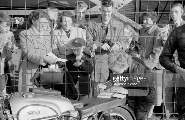 German motorcyclist Inge StollLaforge signing autographs on the seat of her Norton at the TT races in the Isle Of Man Original Publication Picture...