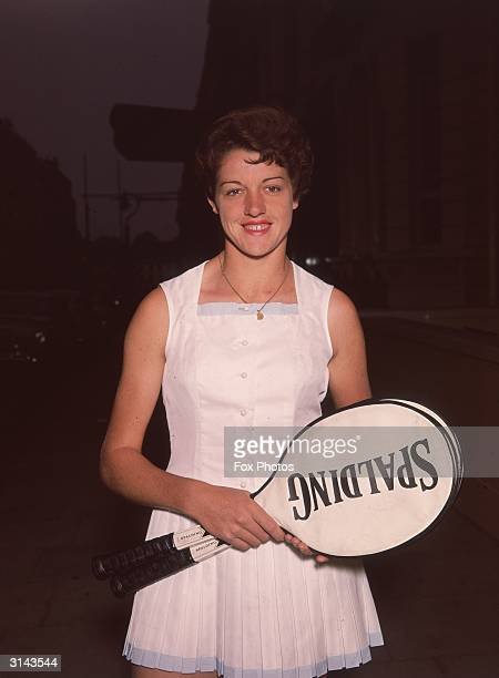 Australian tennis player Margaret Smith carrying a couple of rackets