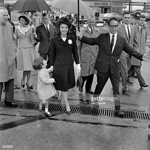 Jackie Kennedy the widow of American President John F Kennedy with her son John Jr at London Airport