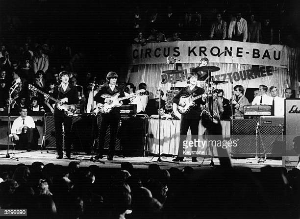Pop group The Beatles performing on stage before thousands at the Circus Krone Bau in Munich part of a short tour of Germany in 1966