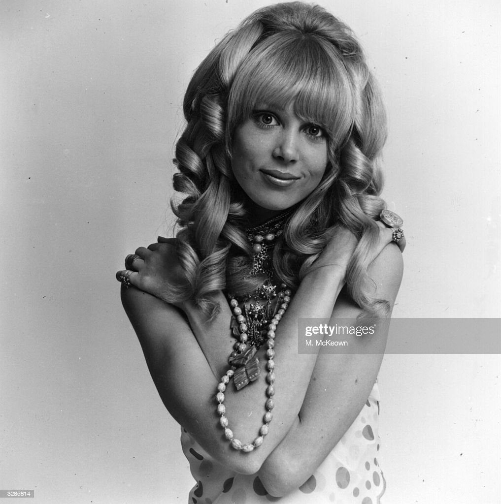 Fashion model Patti Boyd, wife of Beatle George Harrison, modelling a wig.
