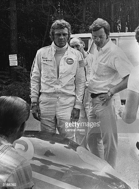 Steve McQueen and John Sturges at the race track where they are filming the sports thriller Le Mans Lee H Katzin went on to direct the film