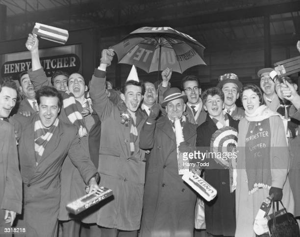 Supporters of Manchester United football club arrive at Euston station in good cheer in London to watch a semifinal replay between United and Fulham...