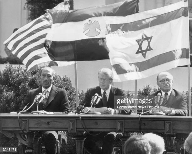 LR Egyptian president Anwar alSadat United States president Jimmy Carter and Israeli prime minister Menachem Begin preparing to sign the Egypt Israel...