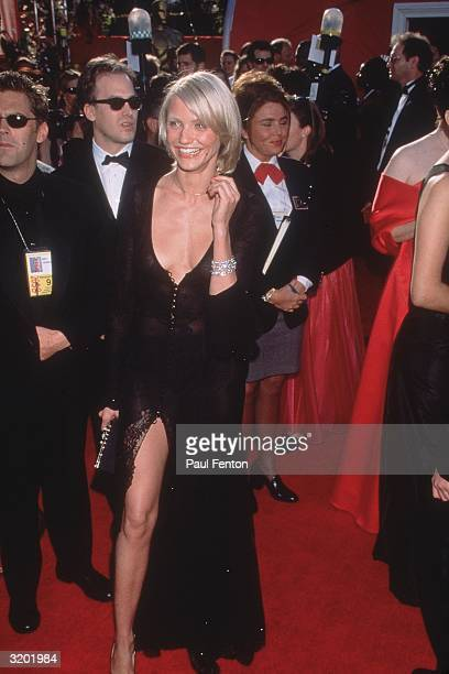 American actor Cameron Diaz in a black Versace gown with a plunging neckline at the Academy Awards Shrine Auditorium Los Angeles California Diaz...