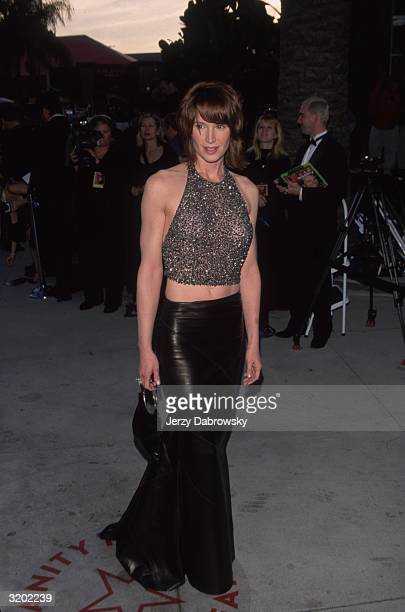 Fulllength image of American actor Kelly Lynch wearing a beaded halter top and long black skirt at the 'Vanity Fair' Oscar Party Morton's restaurant...