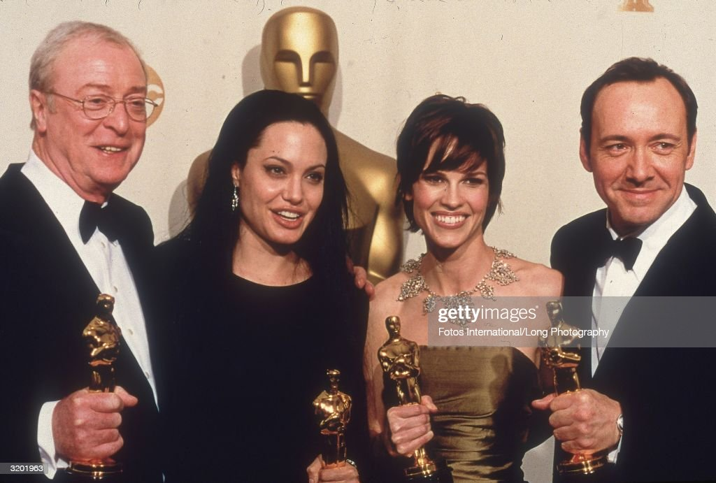 Actors Michael Caine, Angelina Jolie, Hilary Swank and Kevin Spacey hold their Oscar statuettes backstage at the Academy Awards, Shrine Auditorium, Los Angeles, California. Caine won Best Supporting Actor for 'Cider House Rules.' Jolie won Best Supporting Actress for 'Girl, Interrupted.' Swank won Best Actress for 'Boys Don't Cry.' Spacey won Best Actor for 'American Beauty.'