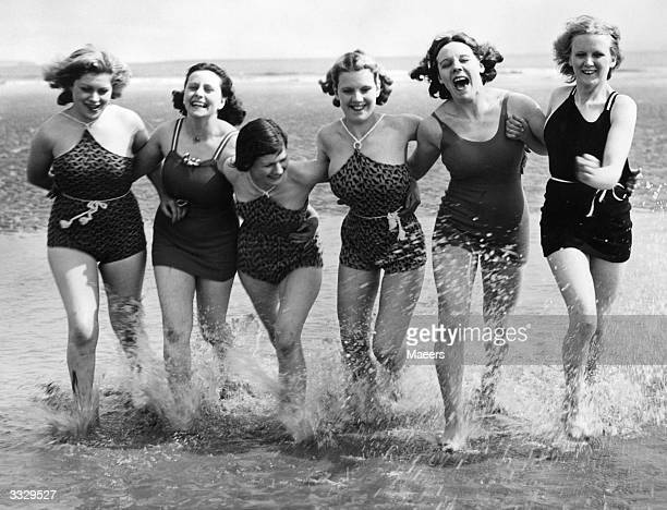 Women enjoying their first dip of the season at Porthcawl South Wales during Whitsun