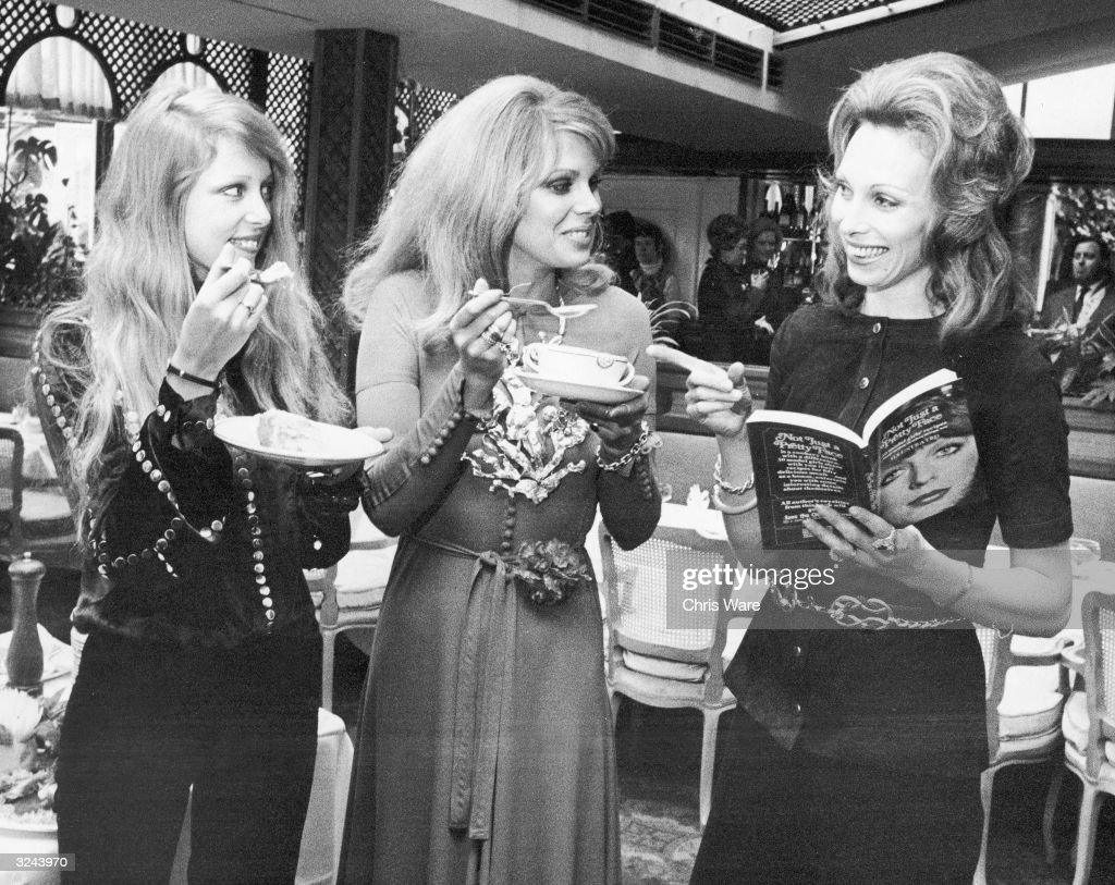 Patti Harrison (left) and Joanna Lumley try out some of the recipes from Gaynor Millington's new cook book, 'Not Just a Pretty Face', during the book launch reception at the Les Ambassadeurs Club, London. Millington (right), a former model herself, has collected favourite recipes from fifty top models for the book, and will be donating the royalties to the Save the Children Fund.