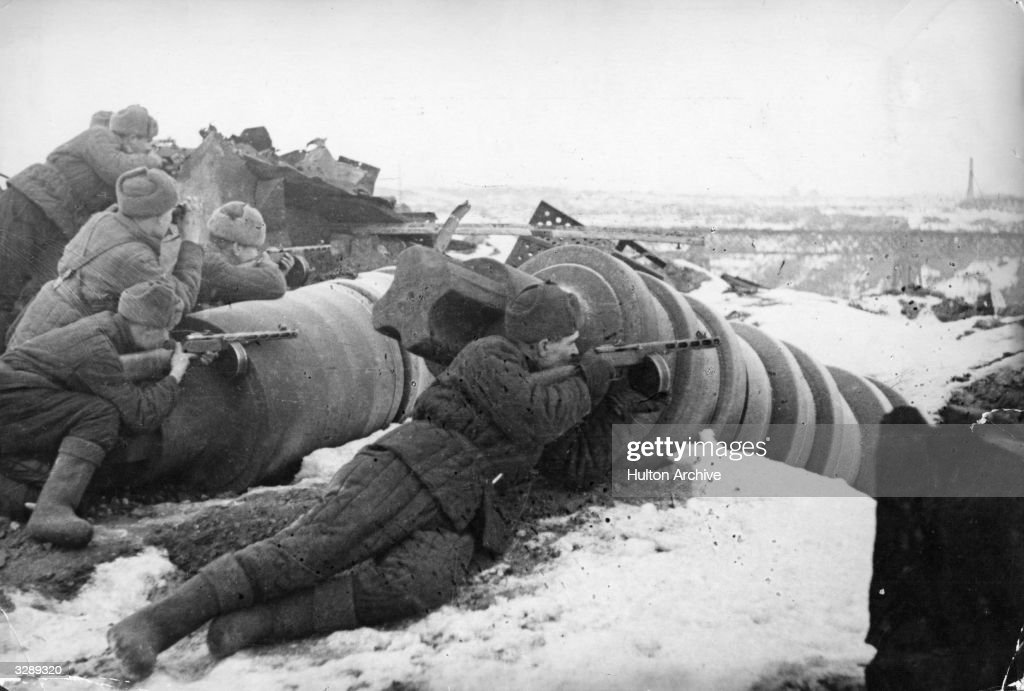 Armed with light machine guns Soviet troops attack the German forces in the vicinity of the Red October plant in Stalingrad