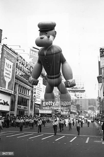 An inflatable model of Popeye takes part in a Thanksgiving Parade near Times Square New York