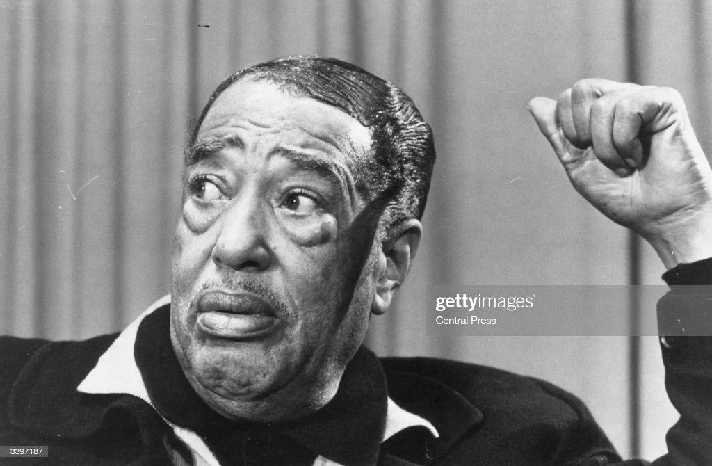 American big band leader and legendary jazz pianist Duke Ellington (1899 - 1974), composer of between 2000 / 5000 tunes, on arrival at Heathrow Airport, London, as part of a world tour.