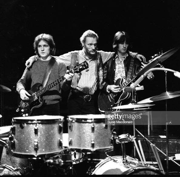 LR Jack Bruce Ginger Baker and Eric Clapton from Cream pose together on stage during their farewell performance at the Royal Albert Hall in London on...