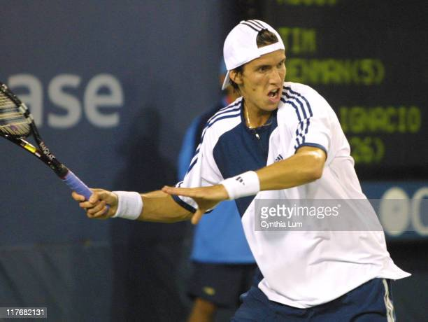 26th seed Juan Ignacio Chela scores a straightset victory over fifth seed Tim Henman 63 63 62