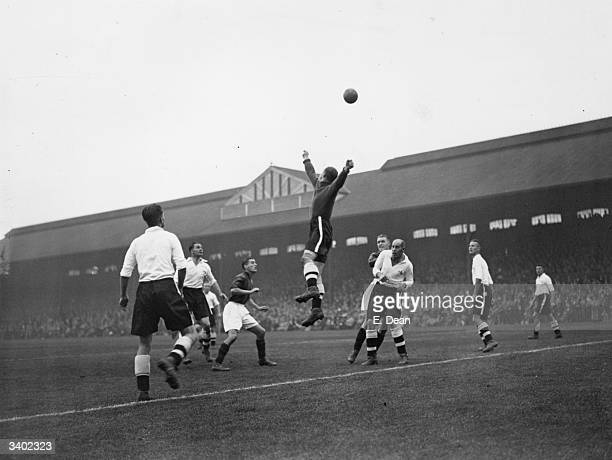 Fulham goalkeeper Tootill punches the ball clear from a Bradford City attack as the two teams play at Craven Cottage