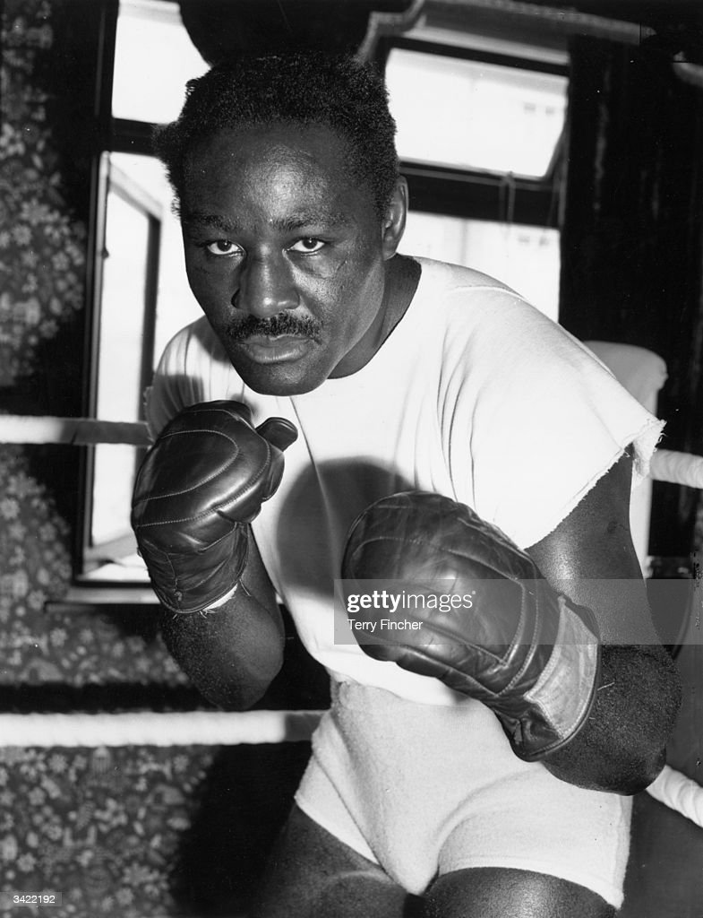 <a gi-track='captionPersonalityLinkClicked' href=/galleries/search?phrase=Ezzard+Charles&family=editorial&specificpeople=215068 ng-click='$event.stopPropagation()'>Ezzard Charles</a>, the former world heavyweight champion, in sparring pose.