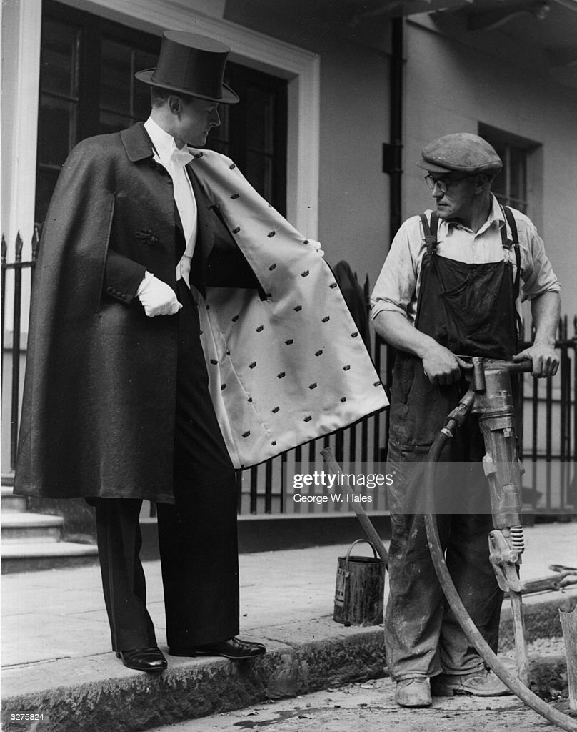Road drill operator Edward Bennett stops work to look in amazement at Douglas Barr's American opera cape with silk and lurex lining, which he is wearing in conjunction with the Lurex International Fair at Mayfair, London.