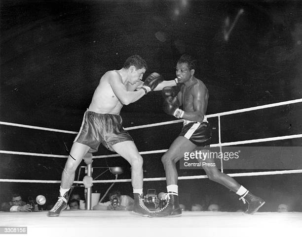 English boxer Terry Downes and Sugar Ray Robinson of the USA during a match at Wembley Stadium London Downes won on points