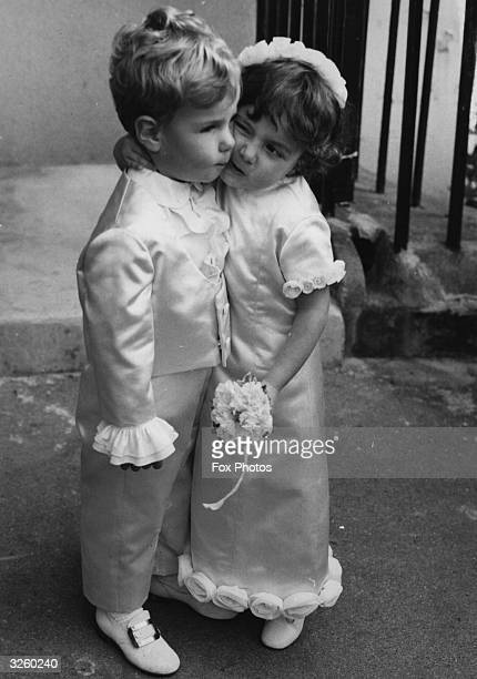 Twoandahalfyearold Portia Forte youngest daughter of restaurant magnate Charles Forte kisses her little cousin Nicholas at the wedding of her older...